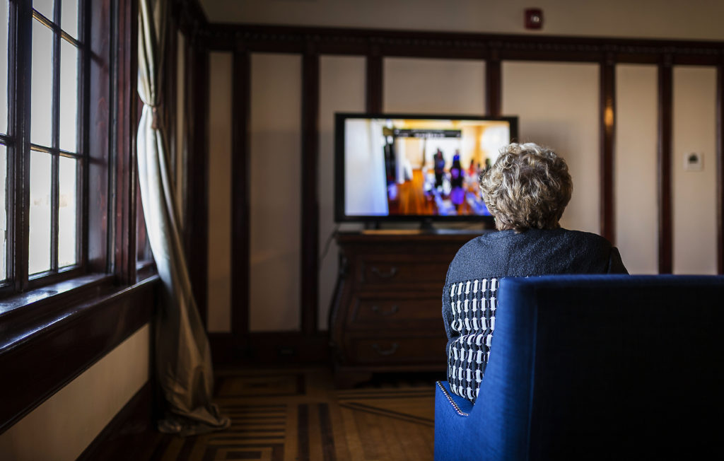 Grandmother Watching Wedding From Home